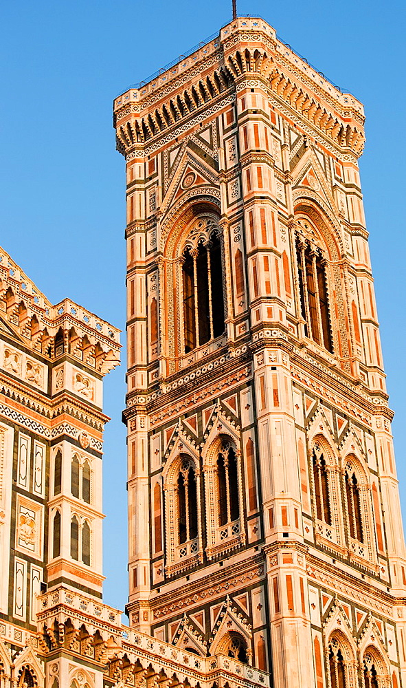 Giottoís Campanile, bell tower, standing adjacent the Basilica of Santa Maria del Fiore, Piazza del Duomo, Florence, Tuscany, Italy.