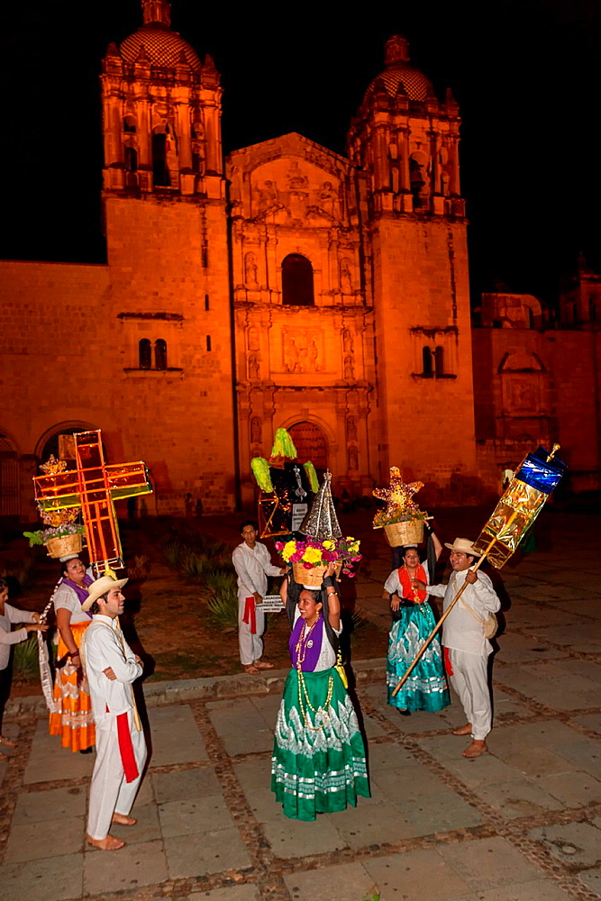 Traditional costumed Mexican dancers in front of the Church of Santo Domingo de Guzmán October 30, 2013 in Oaxaca, Mexico.