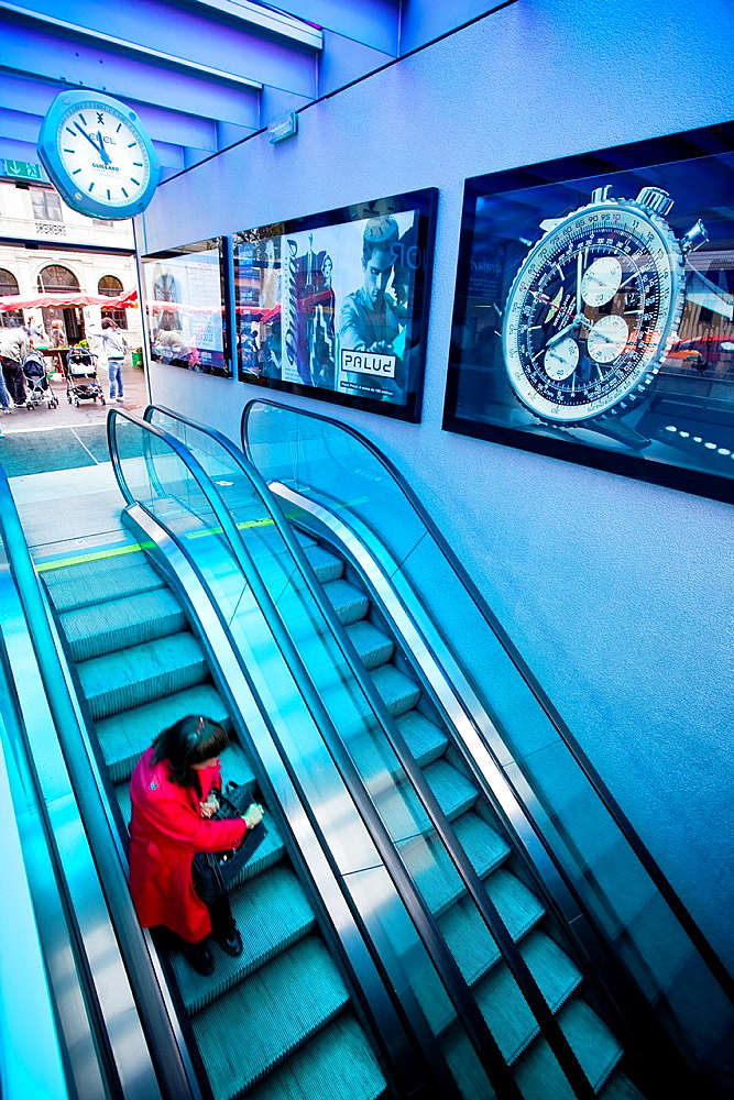 Lausanne metro access with swiss watch advertising. Lausanne, Vaud, Switzerland, Europe.