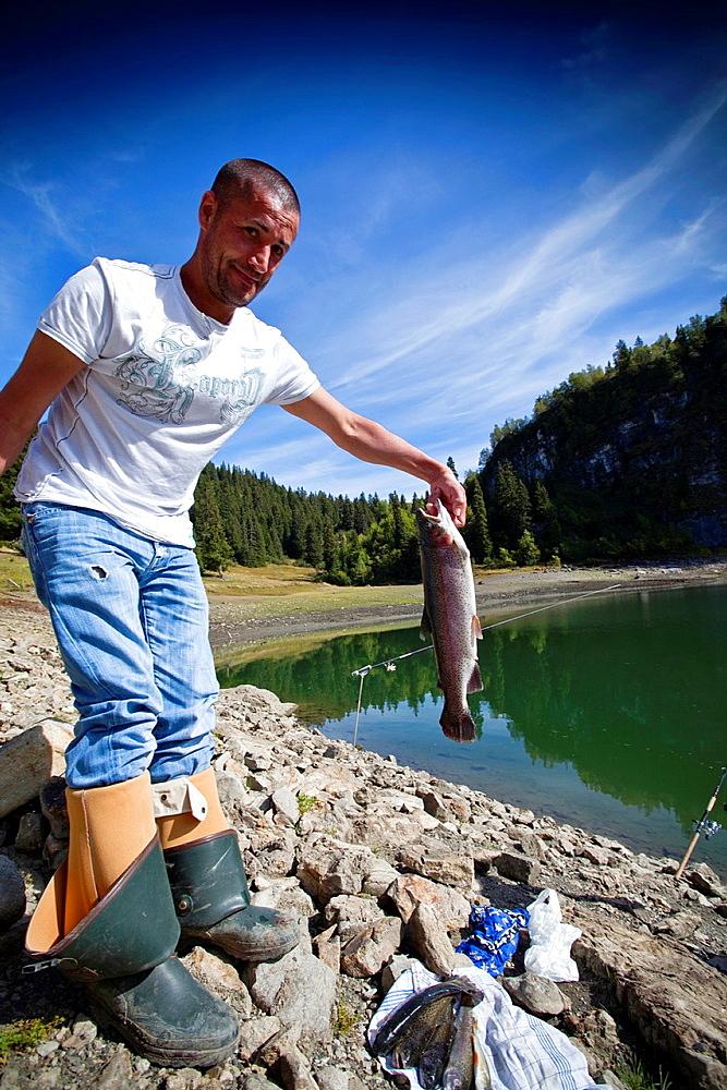 Wild trout fishing on Lake Chavonnes. Villars, Vaud, Switzerland, Europe.