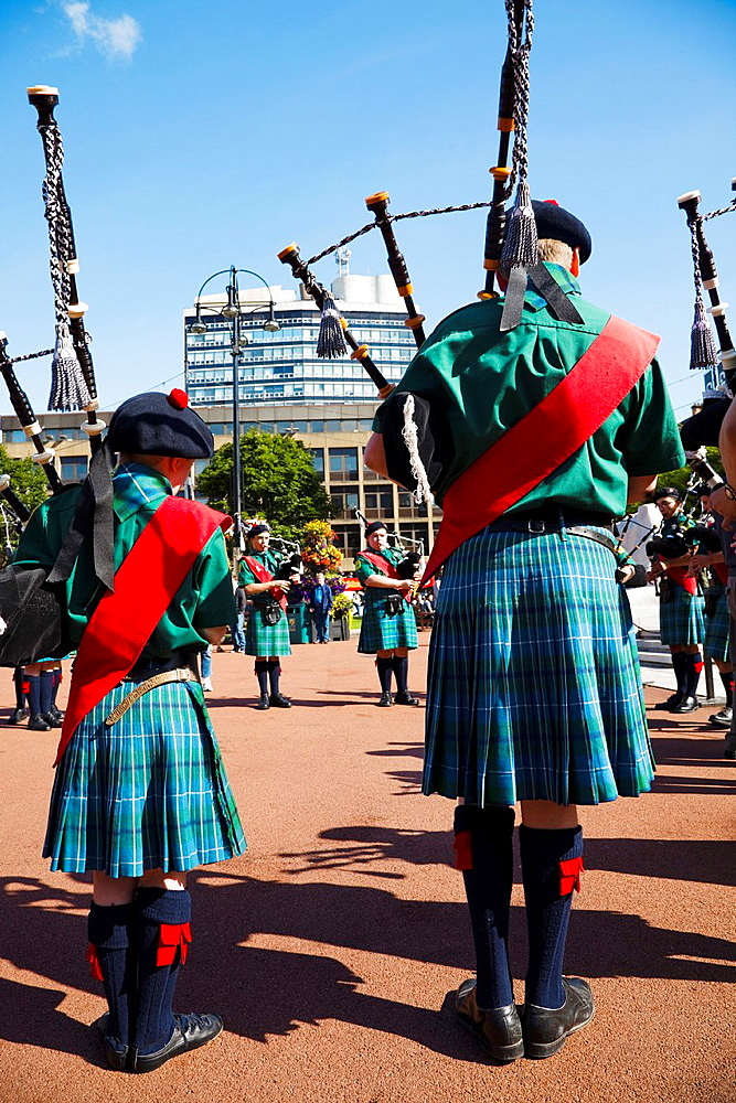 Two pipers playing in George Square, Glasgow, during the International Piping Competition, Scotland