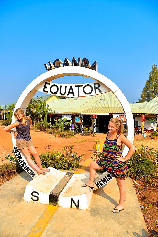 two european girls at the equator-line in Uganda