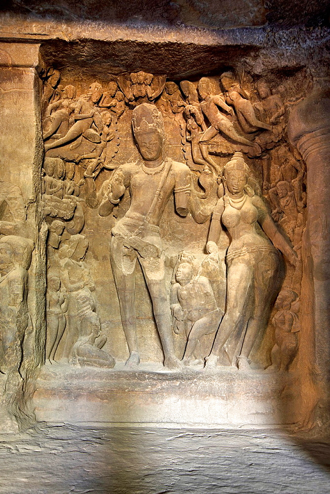 Cave 1 : Elephanta Caves. The Great Cave. Panel of Shiva-Parvati with Gods and attendants. Circa 550 A.D. Maharashtra, India.