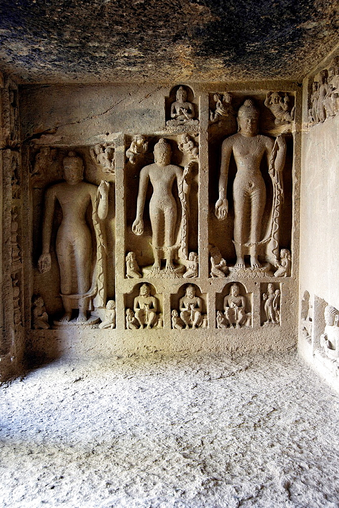 Cave 93 :Standing Buddha figures on the left of Verandah. Kanheri Caves, Borivali, Mumbai, Maharashtra, India
