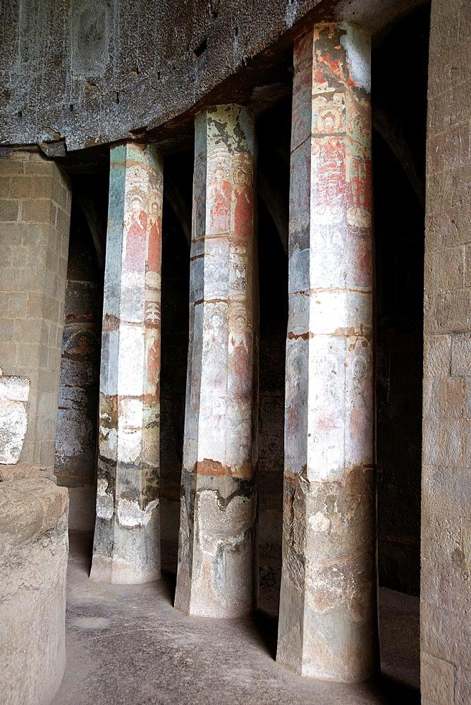 Pitalkhora Caves. Painted standing Buddhas of 5th. Century AD on pillars of Chaitya 3. Aurangabad district, Maharashtra, India.