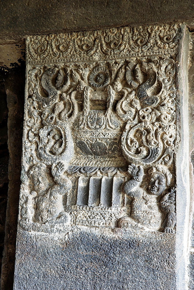 Cave 15, Dashavatara. Detail of pillar shaft with leaf and foliage moitif and dwarf figures at the lower portion. Ellora Caves, Aurangabad, Maharashtra India.