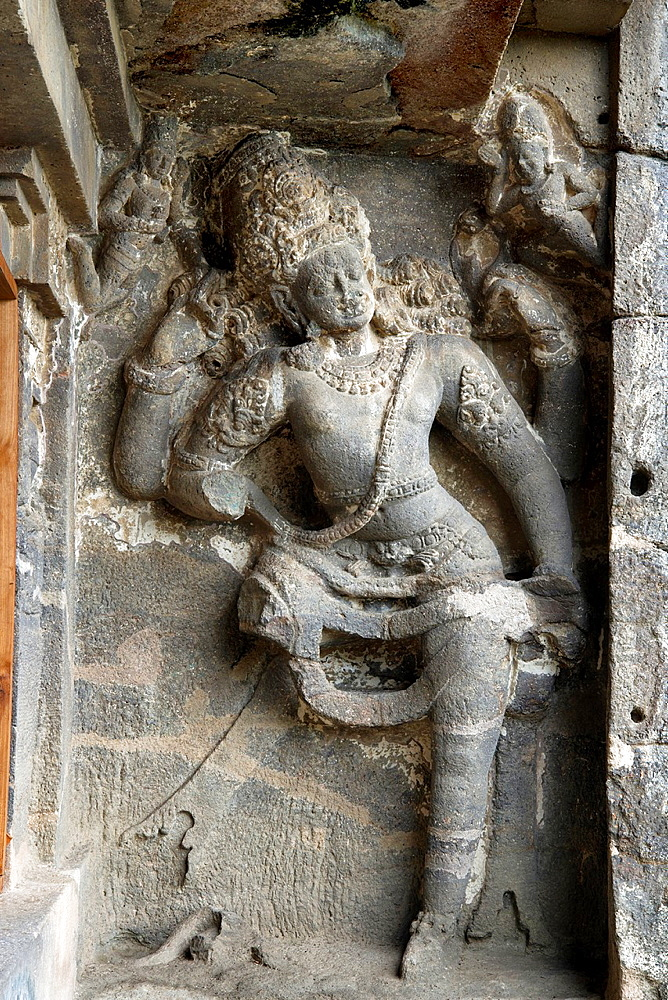 Cave 15, Dashavatara. Four armed Shaiva Dwarapala guardian on the Southern side- facade. Ellora Caves, Aurangabad, Maharashtra India.
