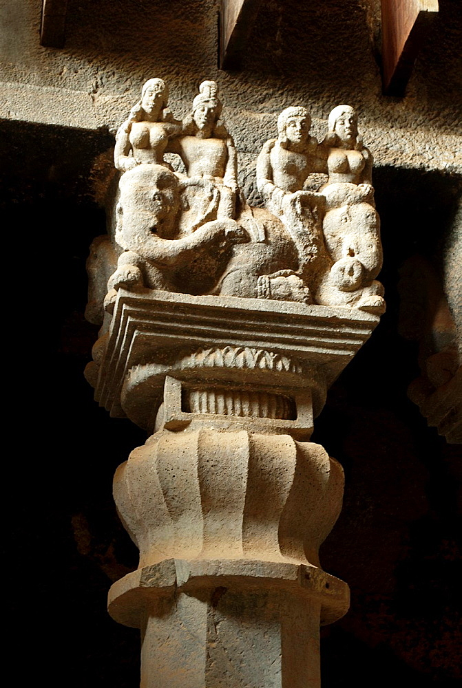 Pillar details in chaitya hall. Shows inverted bell capital with couples riding elephants on upper portion. Karla Caves, dist Pune, Maharashtra, India