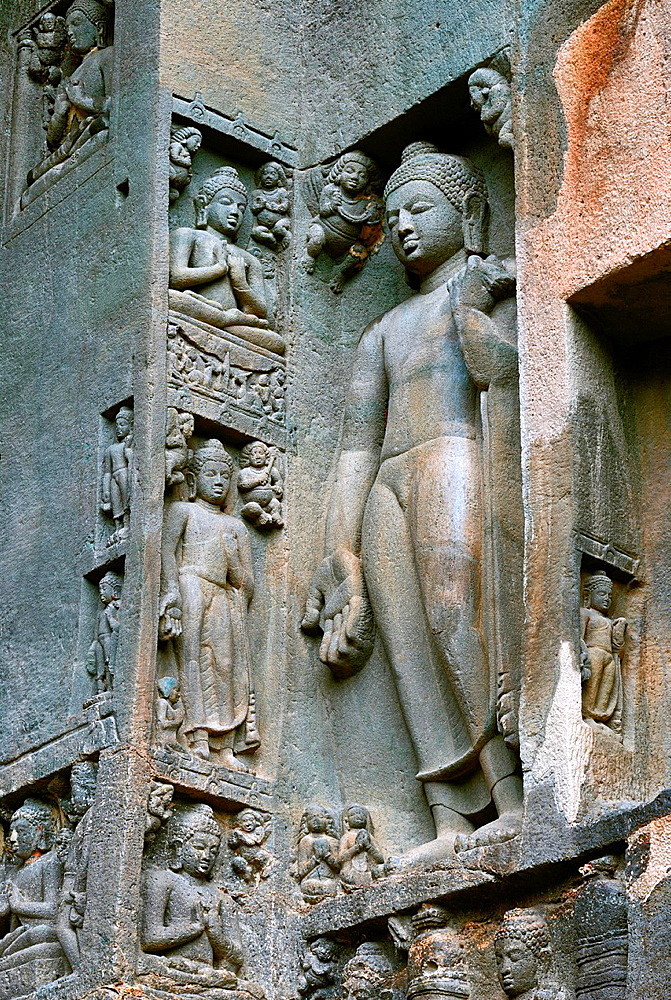 Cave 19 : Right wing of facade showing standing Buddha in Varada mudra. i.e blessings. Ajanta Caves, Aurangabad, Maharashtra, India.