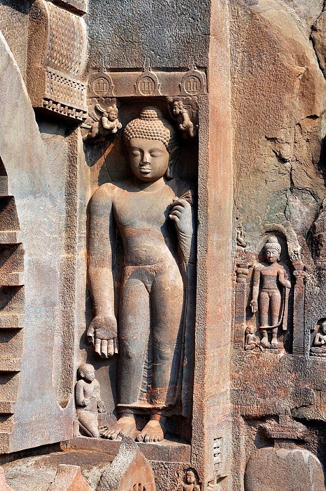 Cave 9: Standing Buddha image on the right of facade. Ajanta Caves, Aurangabad, Maharashtra, India.
