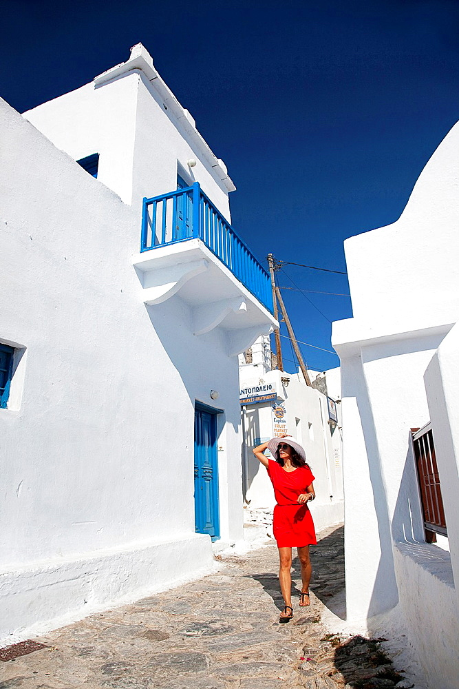 Woman having a walk in town center, Amorgos, Cyclades Islands, Greek Islands, Greece, Europe.