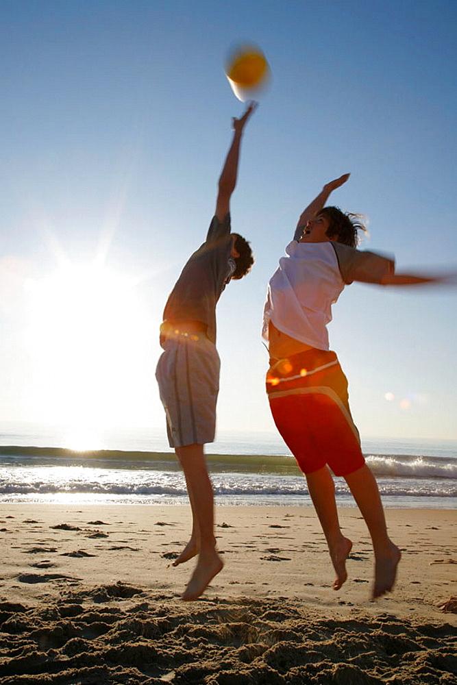Virginia Beach, Virginia, USA, 2 boys playing on the beach, 13 years old.