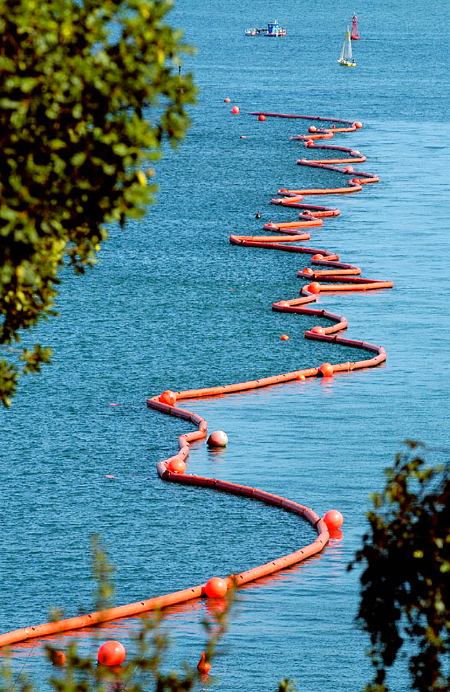 Floating barrier to stop pollution from the fuel spilled by the Prestige Tanker ecological disaster, Bahia de Santander, Cantabria, Spain - 817-65605