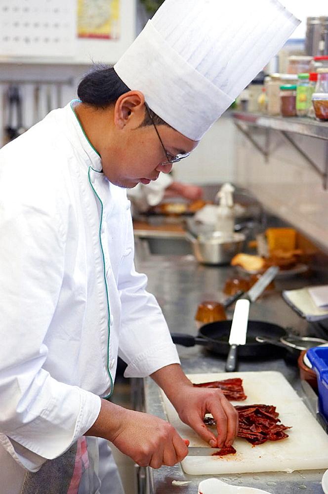 Cutting dry pimientos choriceros, Luis Irizar Cooking School, Donostia, San Sebastian, Gipuzkoa, Euskadi, Spain.