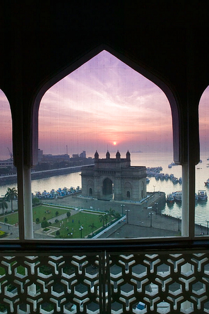 Gateway of India at dawn from Taj Mahal Hotel balcony, seen through mosquito net, Bombay, Maharashtra, India (2004) - 817-79817