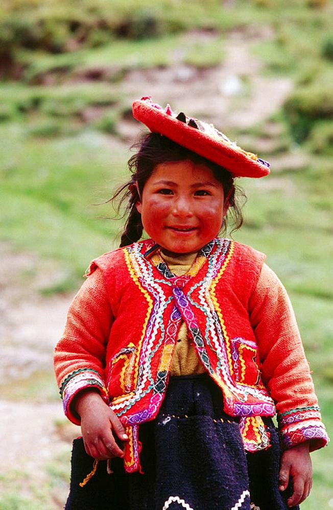 Quechua girl at the inca ruins of Tambo Machay, near Cuzco, Peru