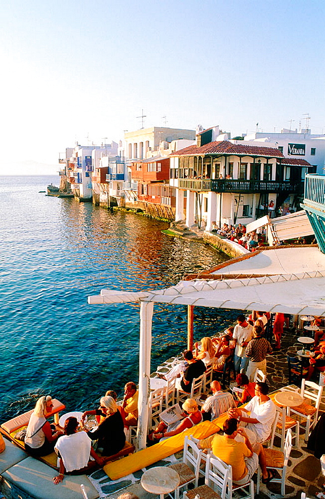 Greece, Cyclades Islands, Mykonos, Having a diner at Sunset, Little Venice in background