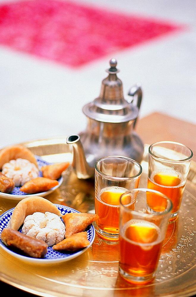 Tea time, roses on the ground, Ryad Cheriffa, Marrakech, Morocco.