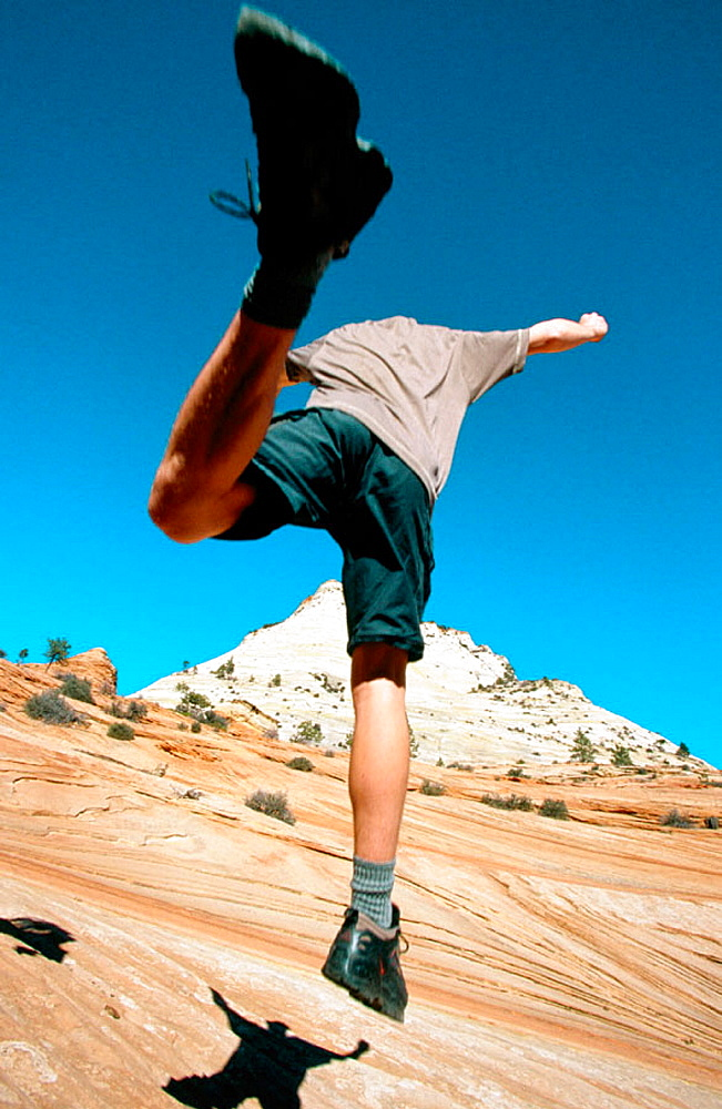 Hiker jumping, Zion National Park, Utah, USA