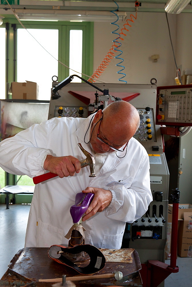 Teacher at work in the pattern making laboratory at Cercal footwear school and research center, San Mauro Pascoli, Emilia-Romagna, Italy, Europe