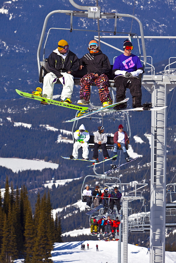 Chairlift carrying skiers and snowboarders, Whistler Mountain, Whistler Blackcomb Ski Resort, Whistler, British Columbia, Canada, North America - 821-144
