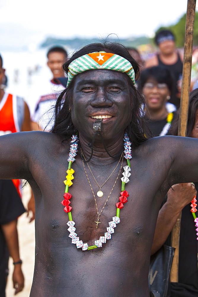 Man covered in black soot, Ati-Atihan Parade along White Beach, during the annual Ati-Atihan Festival, Boracay, Aklan, Philippines, Southeast Asia, Asia