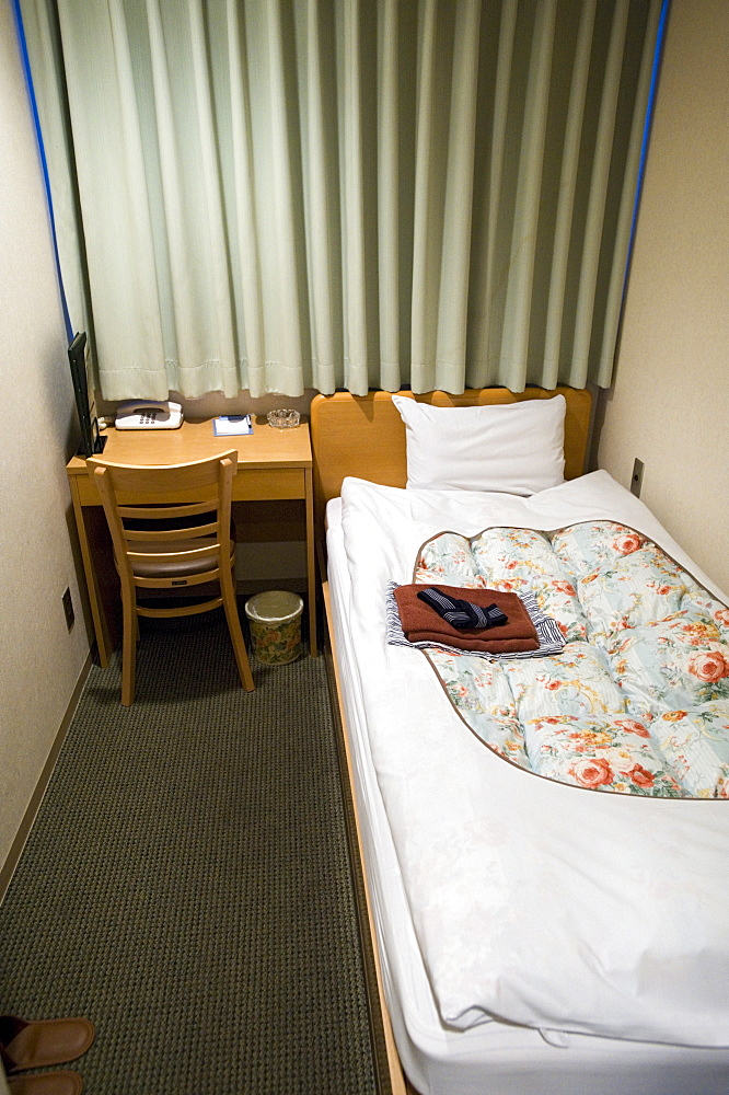 A shoebox-sized hotel room less than two metres wide and costing 8,000 Yen ($80.00)  in central Tokyo, Japan, Asia - 822-126