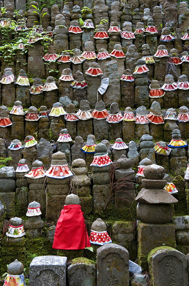 Stone jizo statues with red aprons in the Okunoin Temple cemetery at Koyasan (Mount Koya), Wakayama, Japan, Asia - 822-257