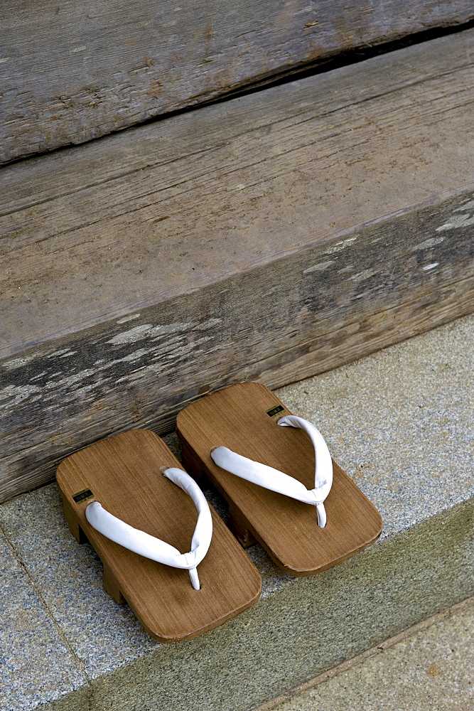 Pair of traditional wooden monk's geta (sandals) at the steps of a Buddhist temple on Mount Koya, Wakayama, Japan, Asia - 822-259