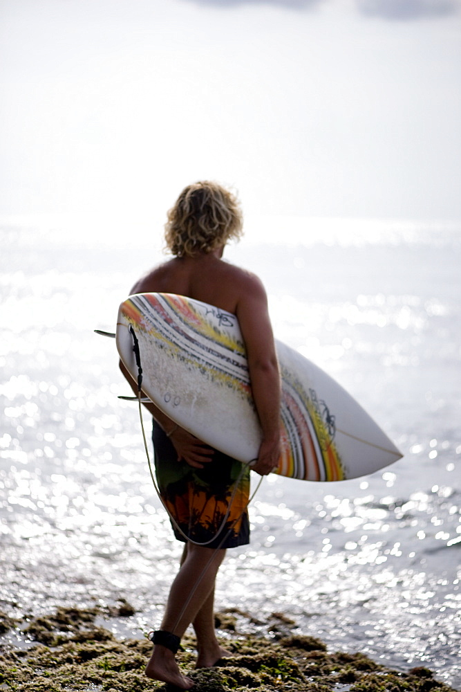 A surfer waits for swell, Bali, Indonesia, Southeast Asia, Asia - 824-81