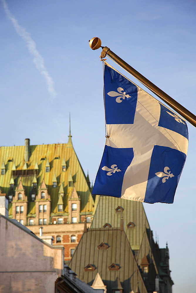 Quebec flag in foreground in front of rooftops of Chateau Frontenac, Quebec City, Quebec, Canada, North America - 825-111