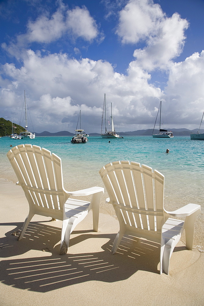 Two empty beach chairs on sandy beach on the island of Jost Van Dyck in the British Virgin Islands, West Indies, Caribbean, Central America - 825-146
