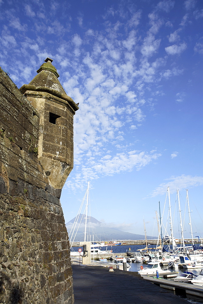 Muralhas de Sao Sebastiao (walls of St. Sebastian), fortress constructed to defend the bay of Porto Paim, and the marina, Horta, island of Faial, with Pico mountain on the island of Pico in the distance, Azores, Portugal, Atlantic, Europe - 825-160