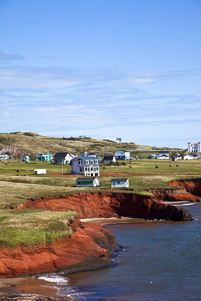 Scalloped red sandstone cliffs with houses perched on the top on the island of Havre-Aubert, Iles de la Madeleine (Magdalen Islands), Quebec, Canada, North America - 825-197