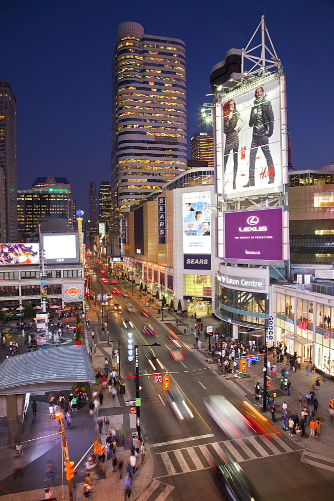 Illuminated signs and Video screens at Dundas Square, in Toronto, Ontario, Canada, North America
