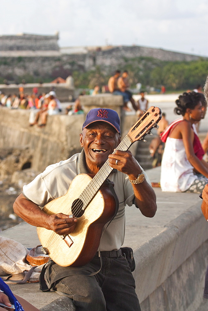 Guitar player on the Malecon in Havana, Cuba, West Indies, Central America