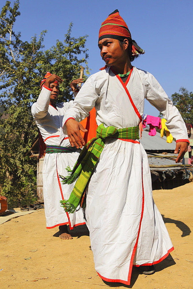 Tripura tribesmen performing a traditional dance wearing white robes, in their village in the Bandarban region of Bangladesh, Asia - 826-591