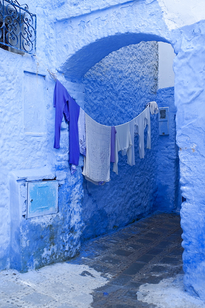 Clothes drying in a typical house entrance, Chefchaouen, Morocco, North Africa, Africa