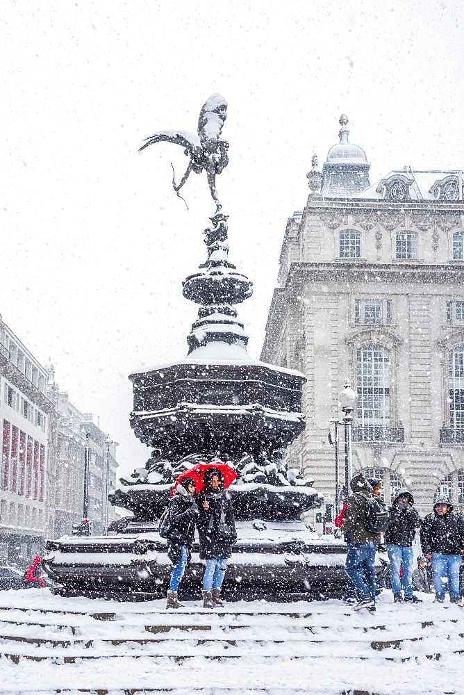 Eros Statue, snow storm, Piccadilly Circus, London, England, United Kingdom, Europe
