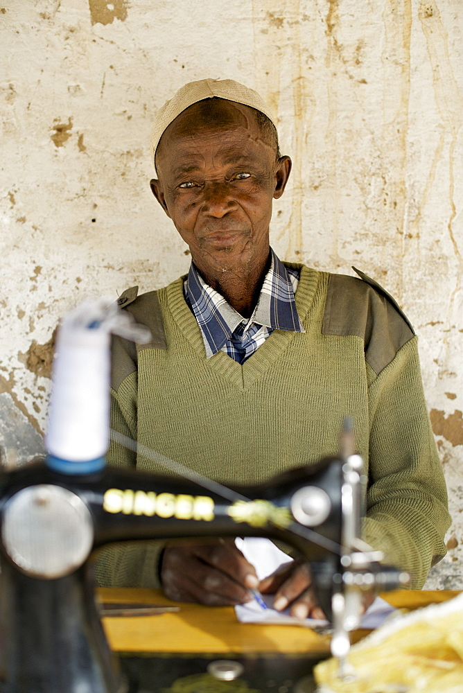 Tailor with sewing machine in Guludo village in the Quirimbas National Park in northern Mozambique, Africa