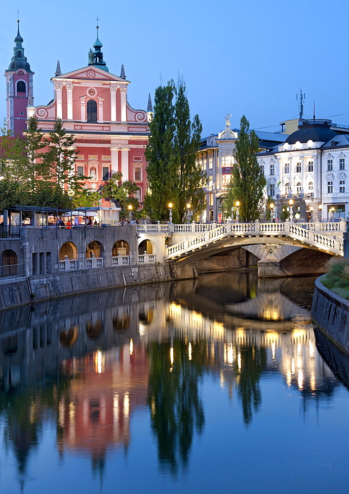 The Franciscan Church of the Annunciation and the Triple Bridge over the Ljubljanica River in Ljubljana, Slovenia, Europe