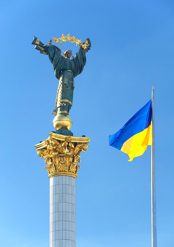 Ukrainian flag and Independence column in Independence Square (Maidan Nezalezhnosti) in Kiev, the capital of Ukraine, Europe