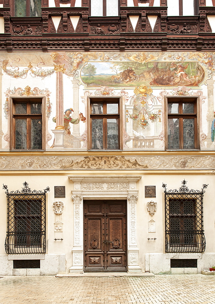 Mural and architectural detail in the courtyard of Peles Castle in Sinaia in the Carpathian mountains in the Transylvania region of central Romania, Europe