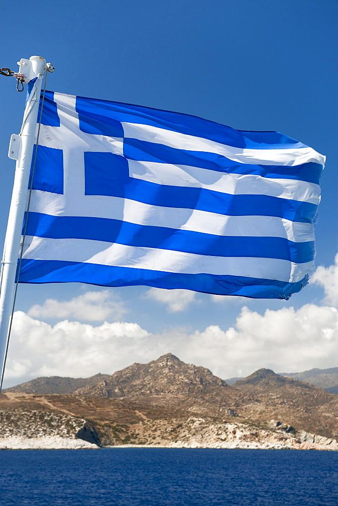 Greek flag seen against a view of Naxos island, Cyclades, Greek Islands, Greece, Europe - 829-2082