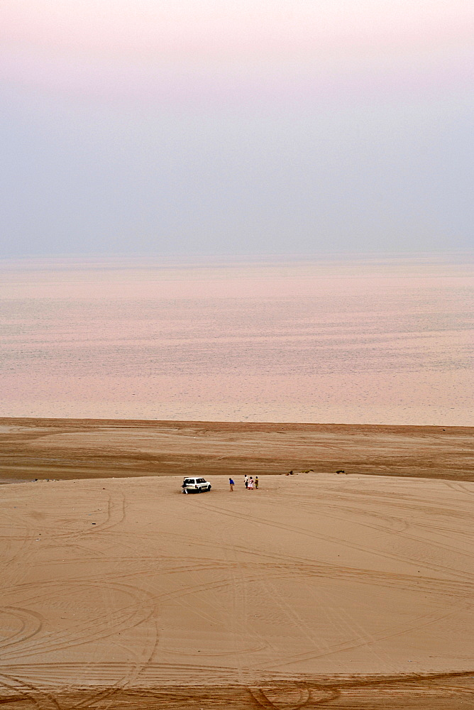 Visitors and their 4X4 at the Inland Sea (Khor al Adaid) in southern Qatar.