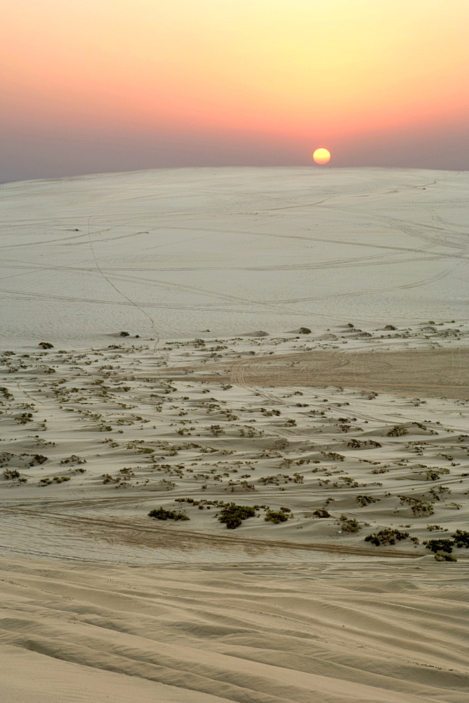Sunset over the Inland Sea (Khor al Adaid) in southern Qatar.
