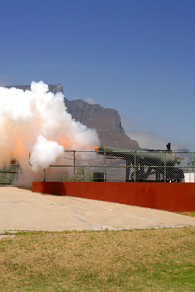 The noon gun firing in Cape Town. The daily noon gun is Cape Town's oldest living tradition and the two cannons used are the oldest guns in daily use in the world. They have marked the midday hour in the mother city in this distinctive, albeit noisy manner since early 1806. The cannons were cast in Britain in 1794 and still bear the royal crest of King George the third. The firing of the cannon was originally to give ships in the bay a means of re-setting their clocks accurately.