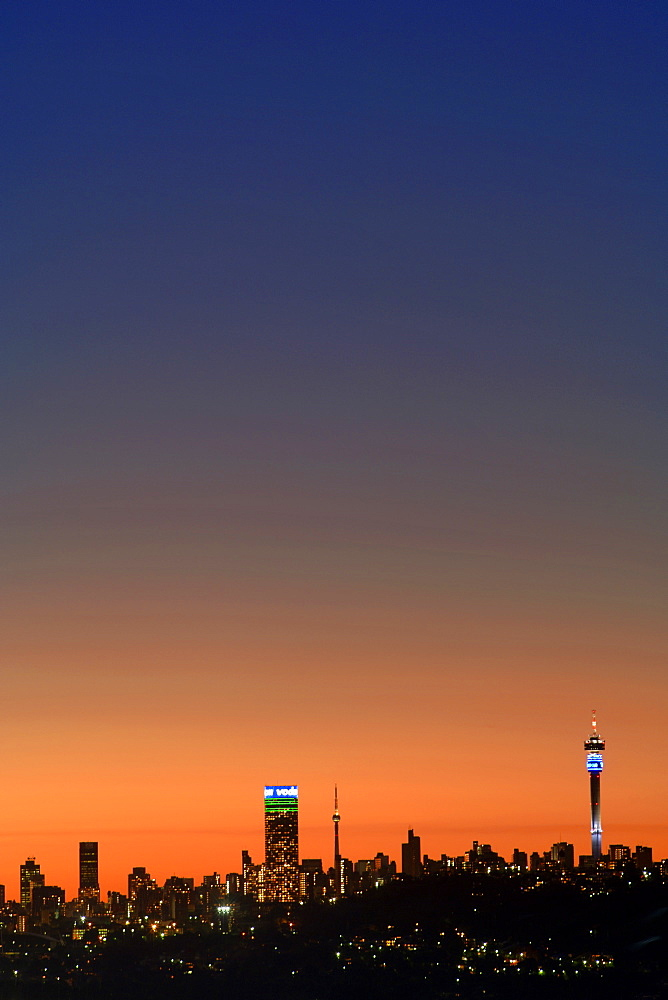 The Johannesburg skyline at dusk.