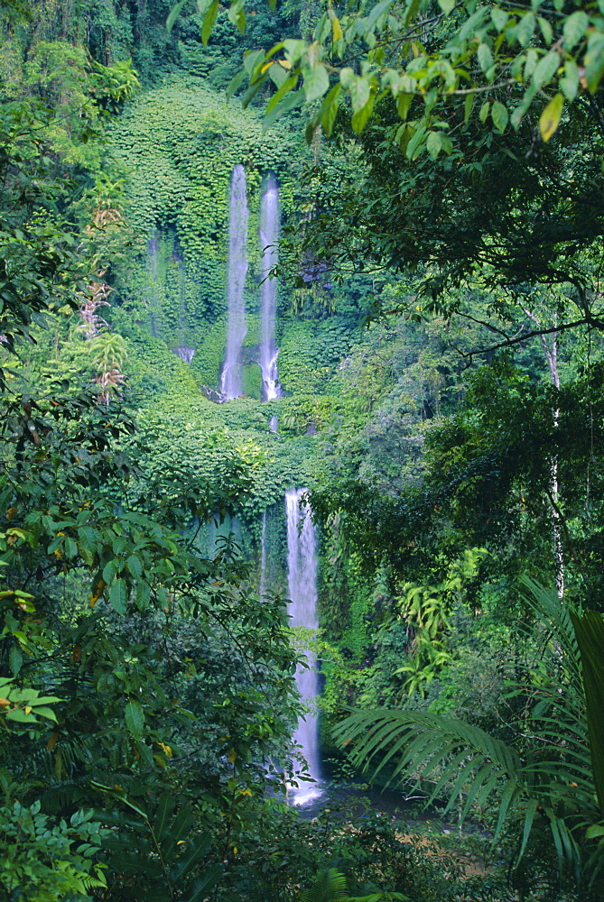 Waterfall on the northern slopes of 3726m Mt Rinjani volcano, near Senaru, Lombok, Indonesia