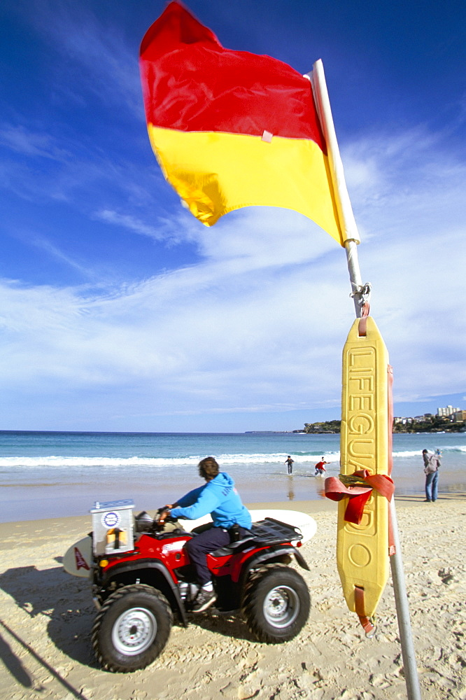 Swimming flag and patrolling lifeguard at Bondi Beach, Sydney, New South Wales, Australia, Pacific